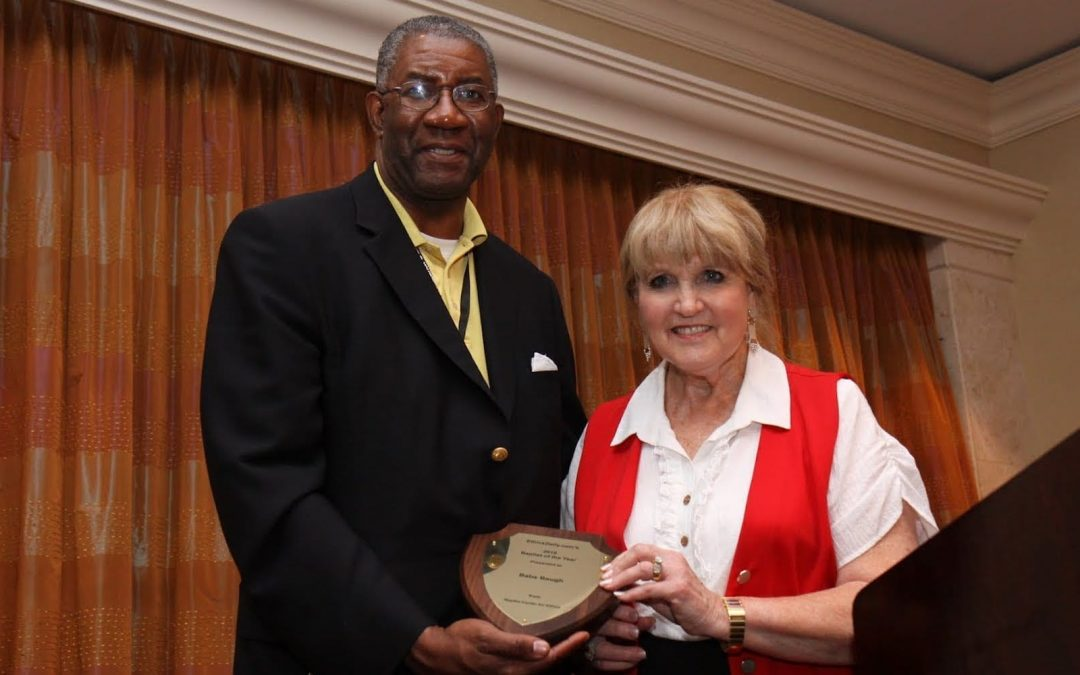 Wendell Griffen presenting Babs Baugh the Baptist of the Year Award