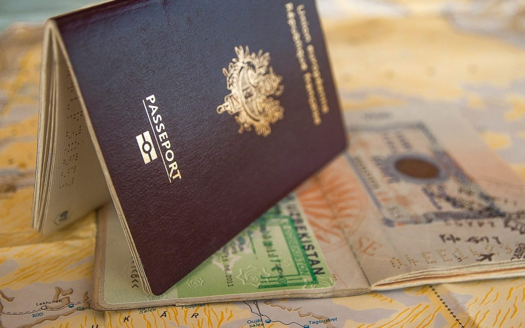 A passport sitting on a map.