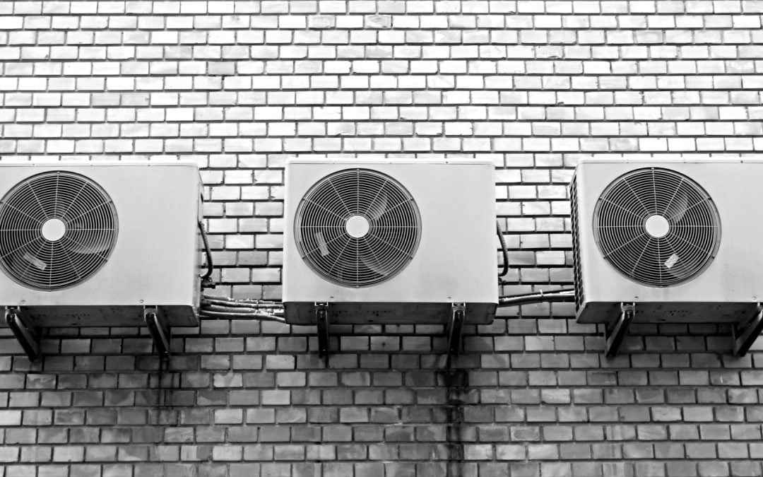 Air condition units sitting on gray tile