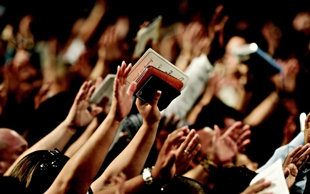 Hands raised during a worship service at church