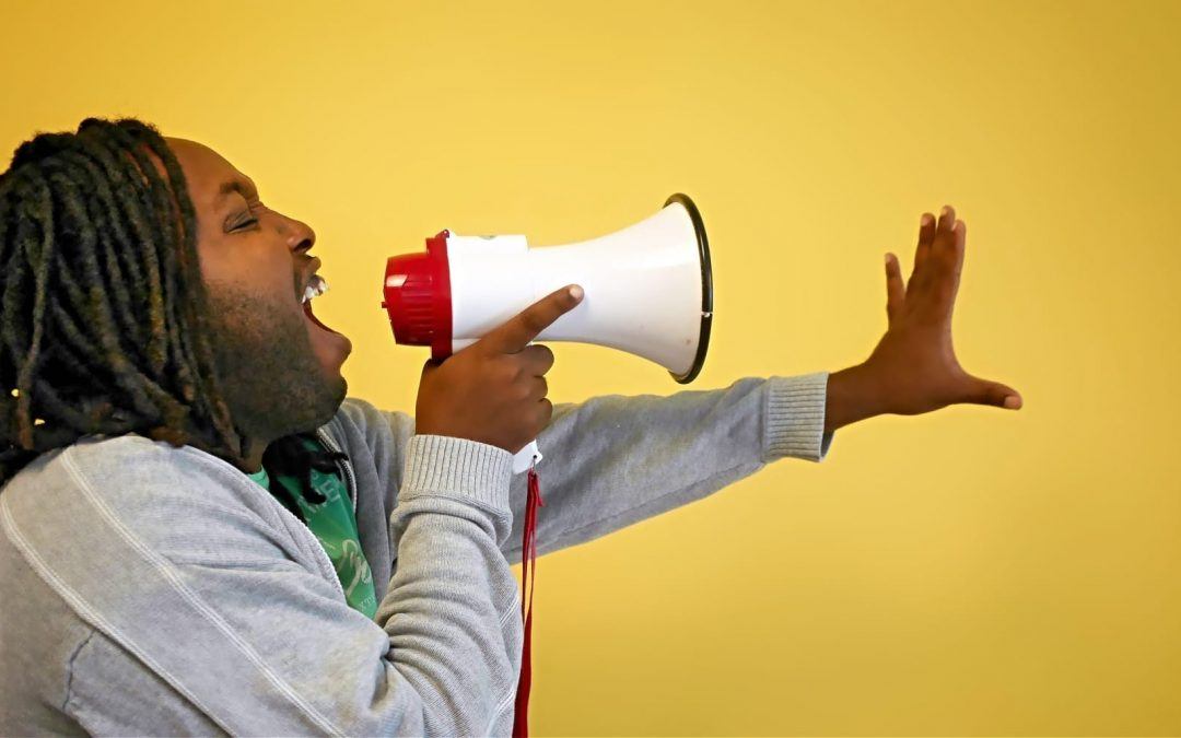 A man yelling into a megaphone