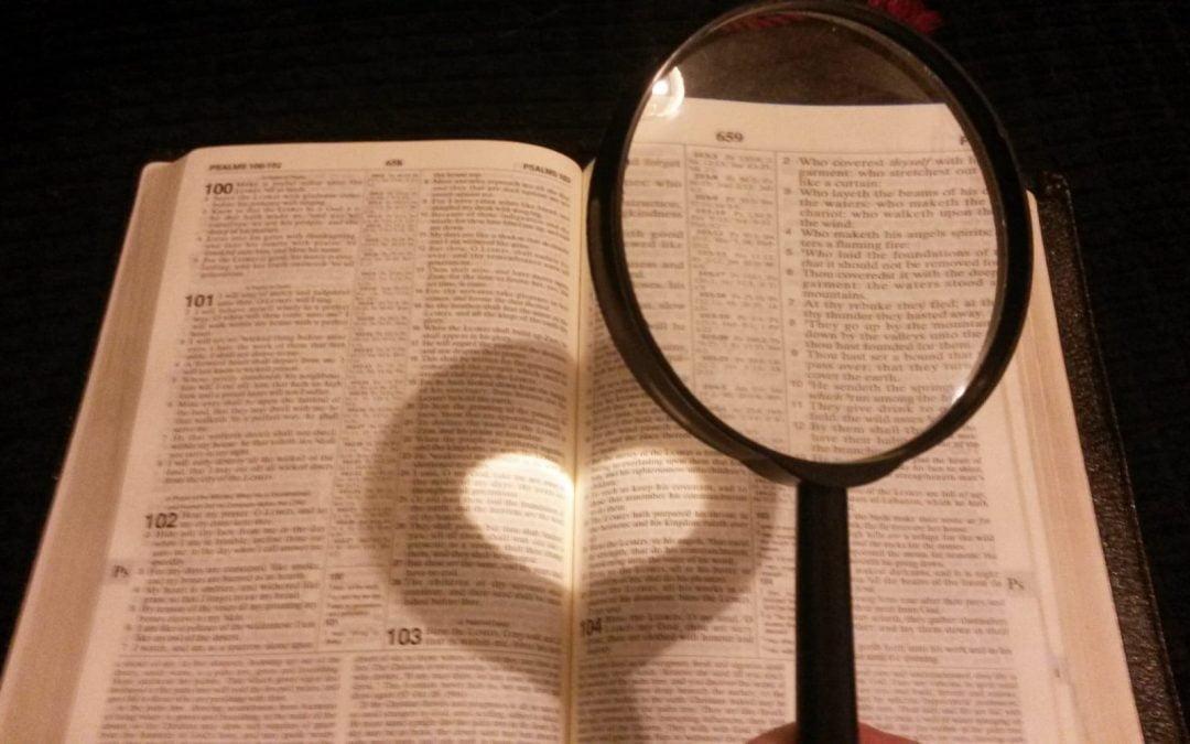 A Bible seen through a magnifying glass
