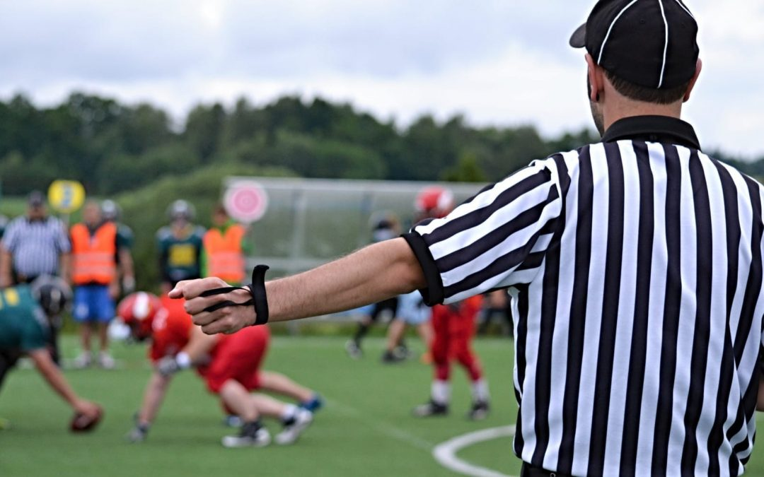 A football referee officiating a game