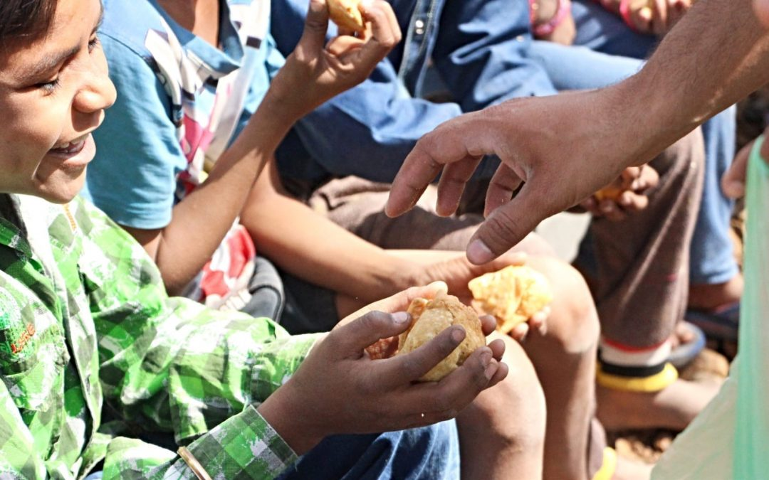 Young children being given bread
