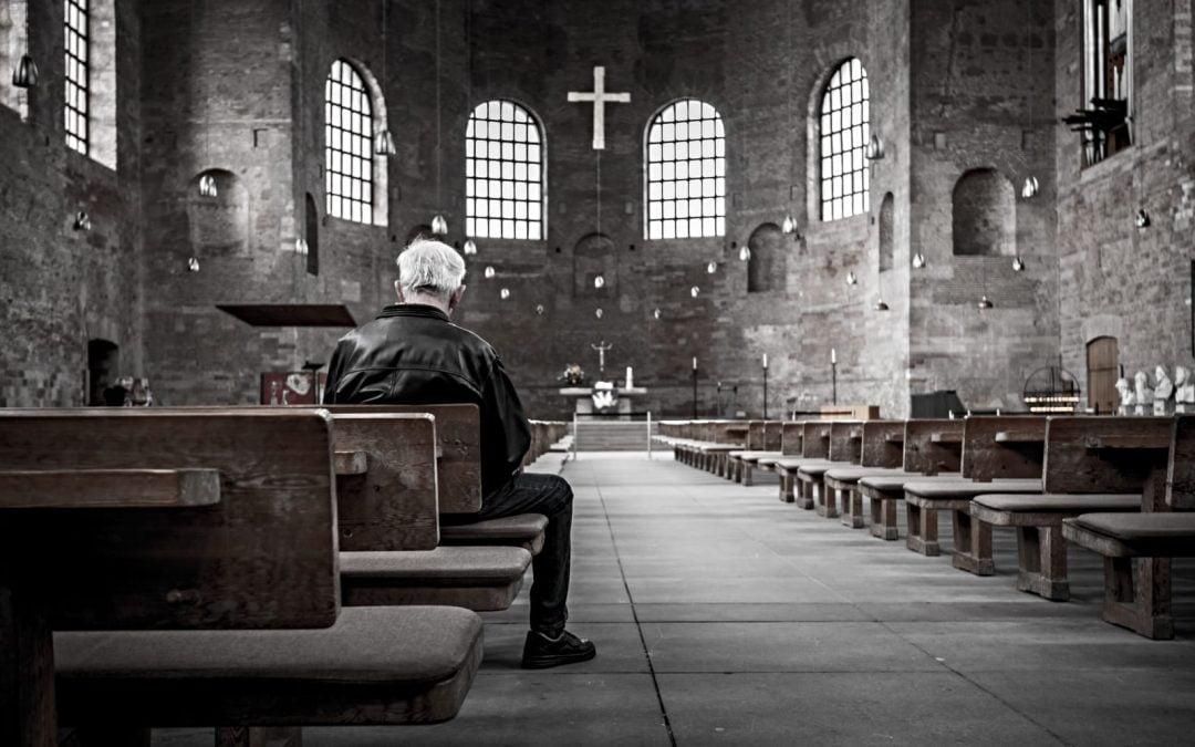 A man sitting alone in a church