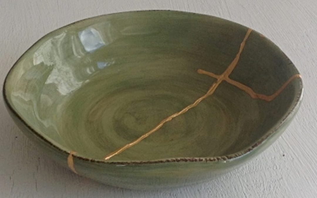 A green bowl glued back together