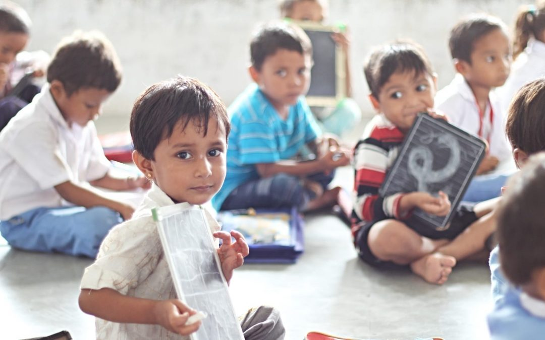 Children sitting on the floor in a classroom