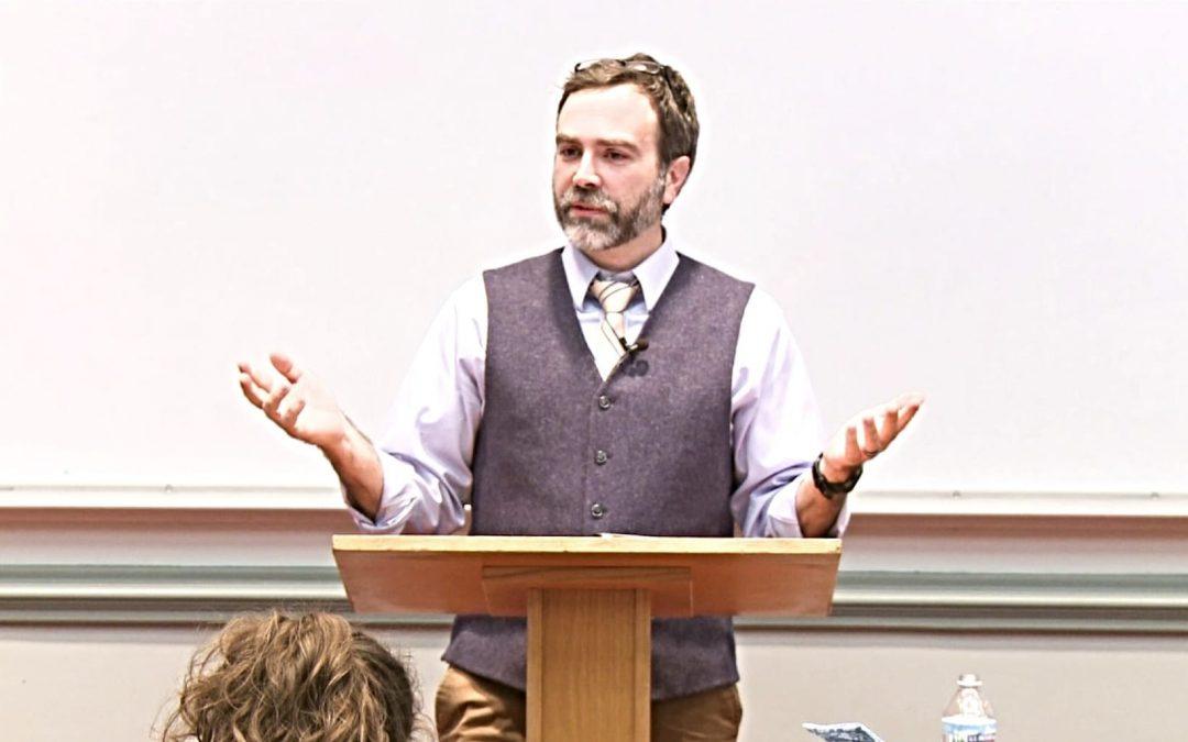 Miles Wertnz speaking during a class