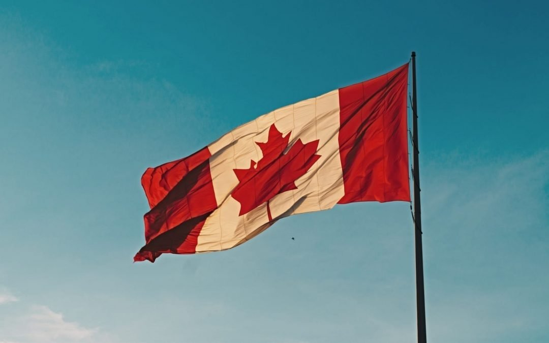 A Canadian flag set against a teal sky