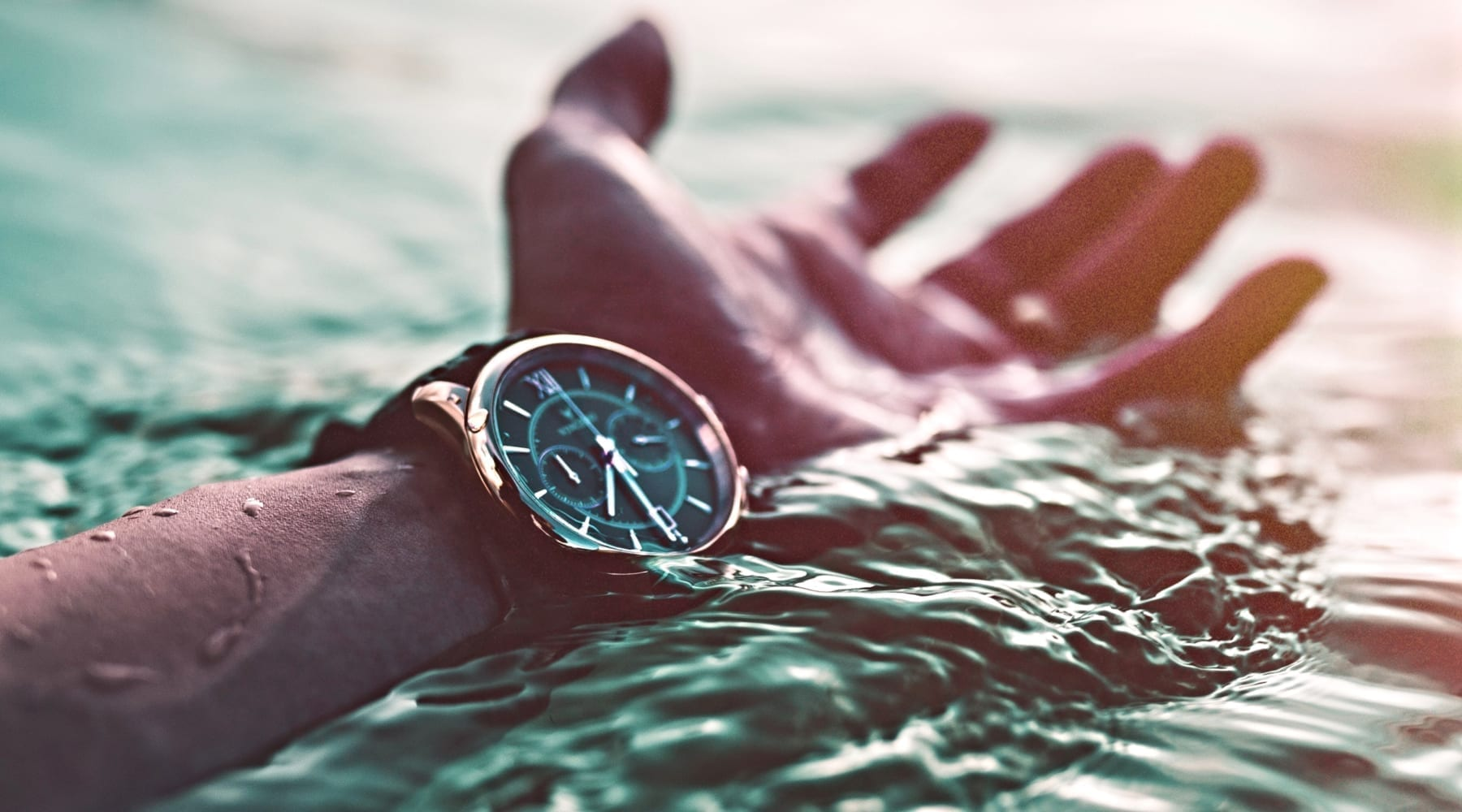 A wrist watch almost under the water