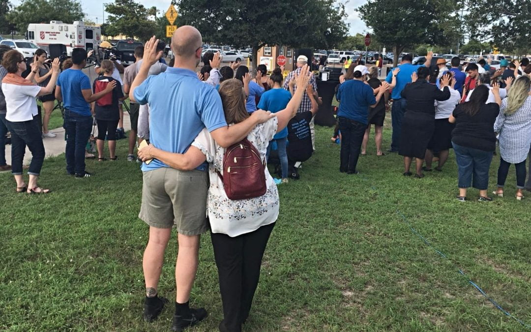 A prayer vigil takes place outside the Southwest Key shelter in south Texas