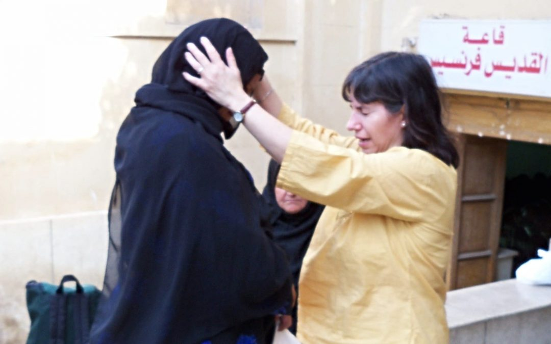 Nora Lozano praying for a woman