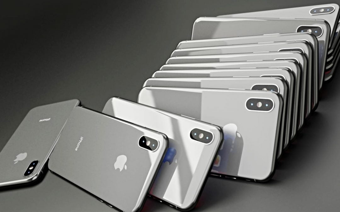 A stack of silver iPhones