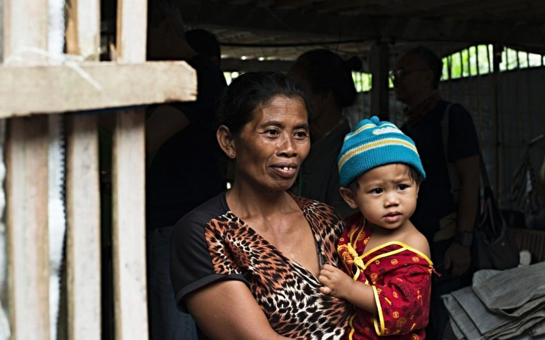 A woman holding a young child