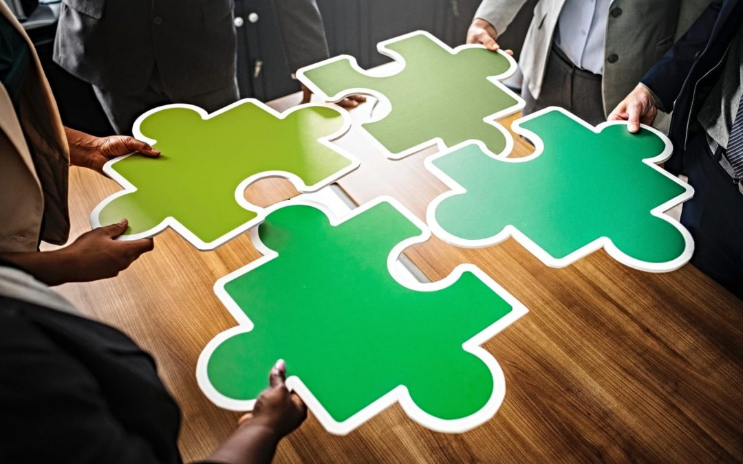 Large green puzzle pieces on wooden desk