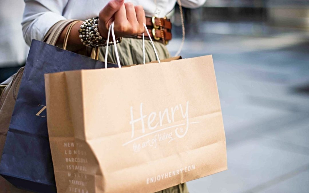 Woman holding a brown shopping bag