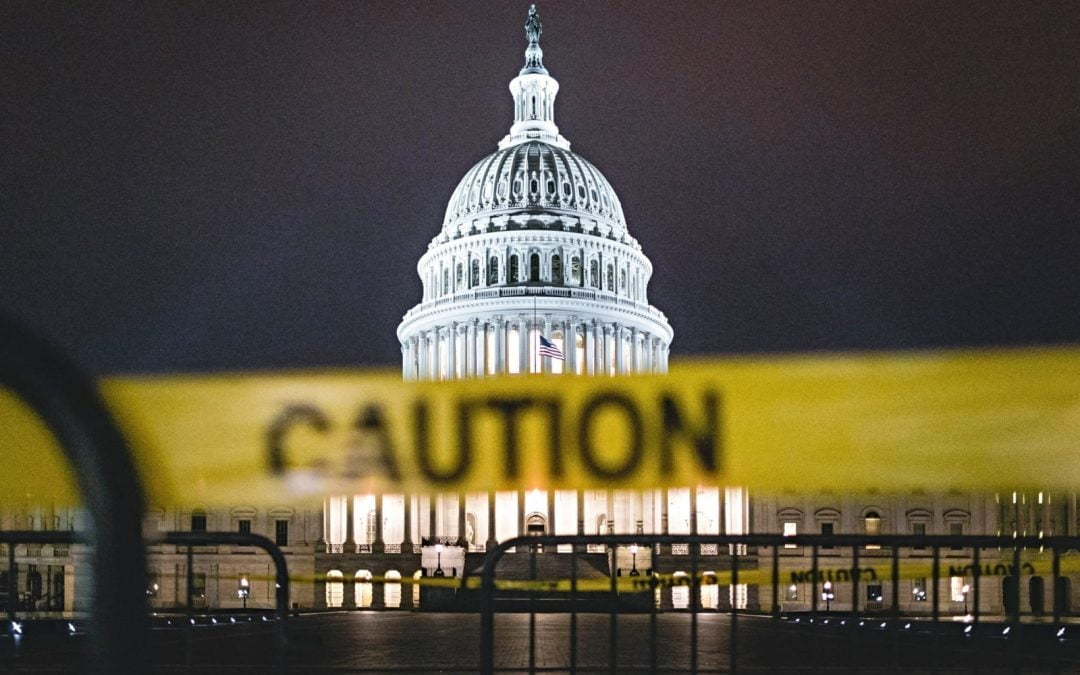 U.S. Capitol Building at night with caution tape in foreground