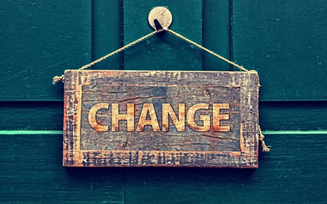 Change sign hanging on green door