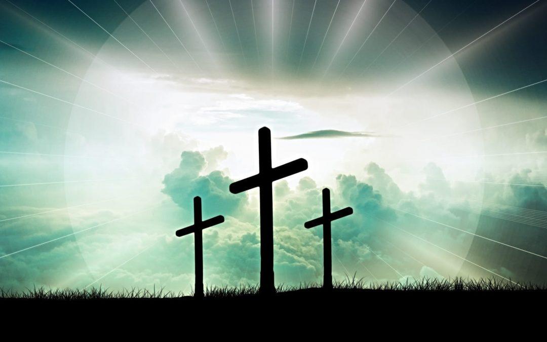 Three crosses backlit by sun