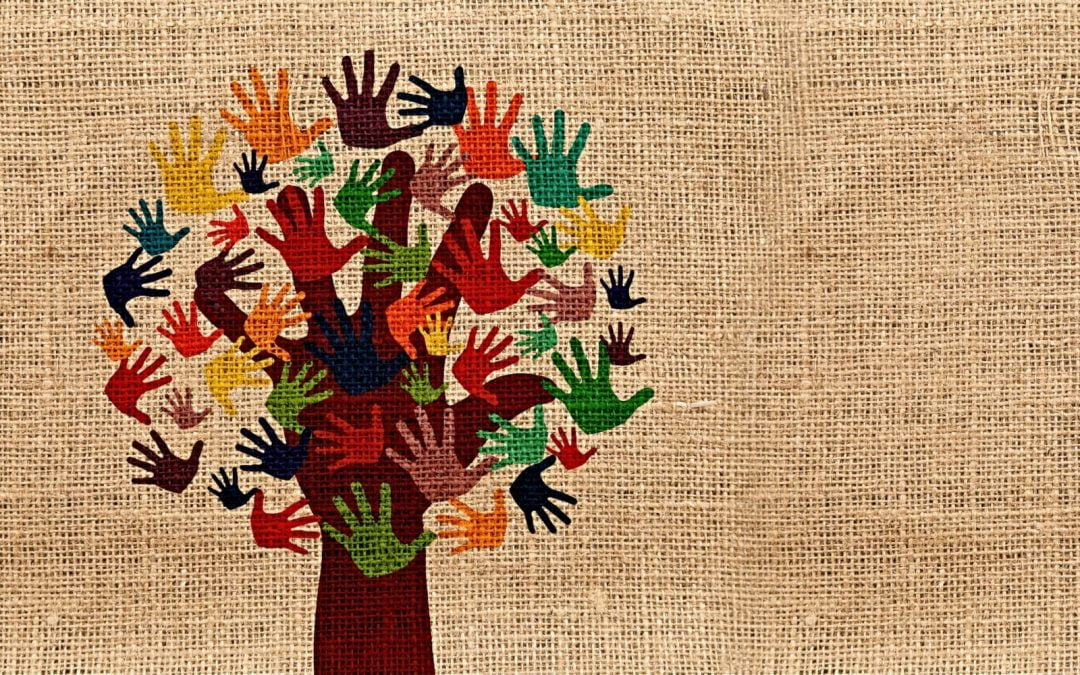 Artwork of tree of multicolored hands