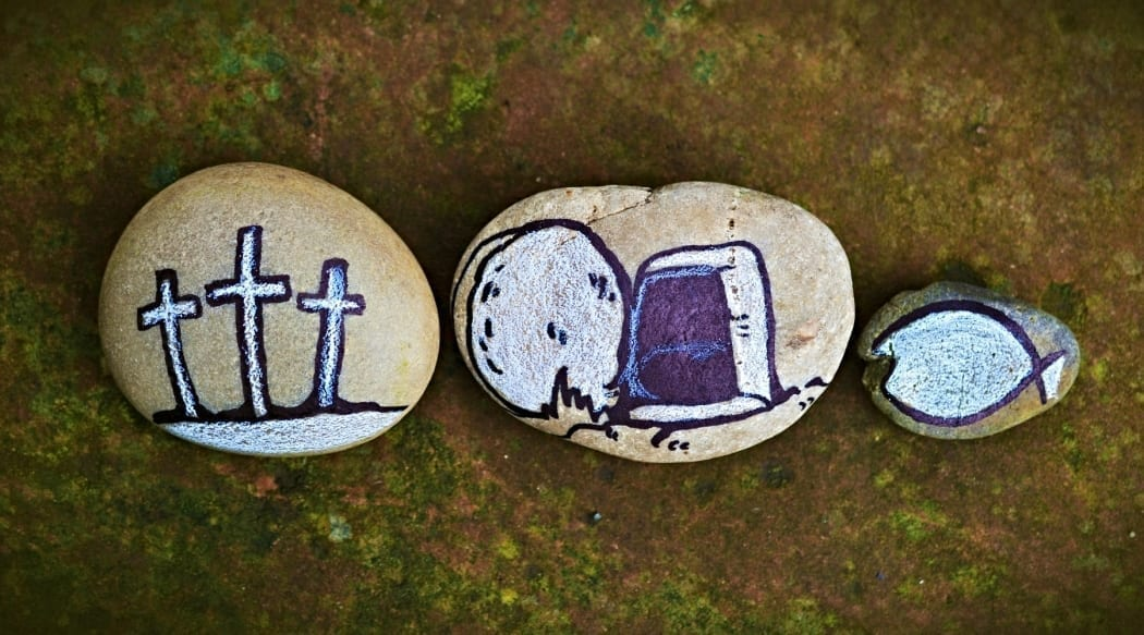 Three stones with paintings of resurrection story