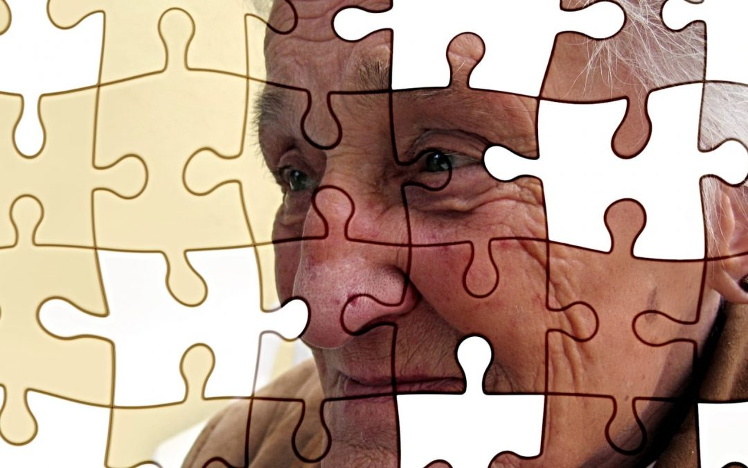 Jigsaw puzzle of older man with pieces missing