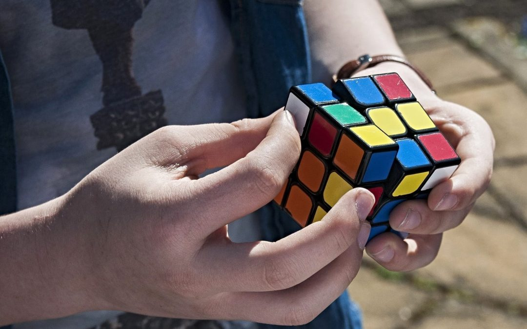 Close-up of hands solving a Rubik's cube