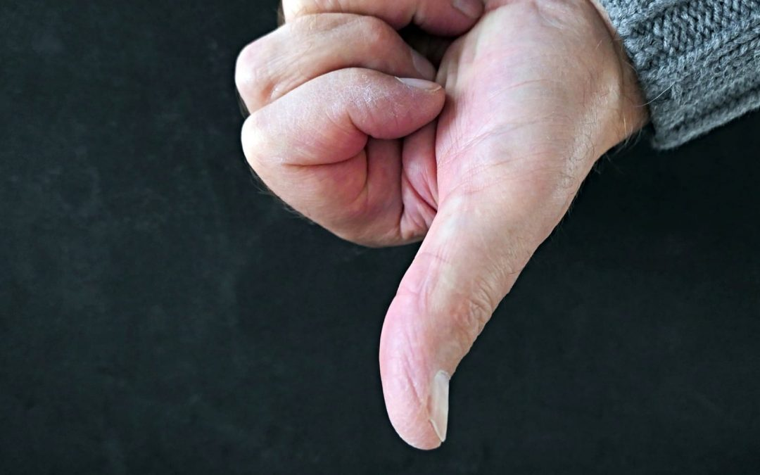 Hand making thumbs-down gesture
