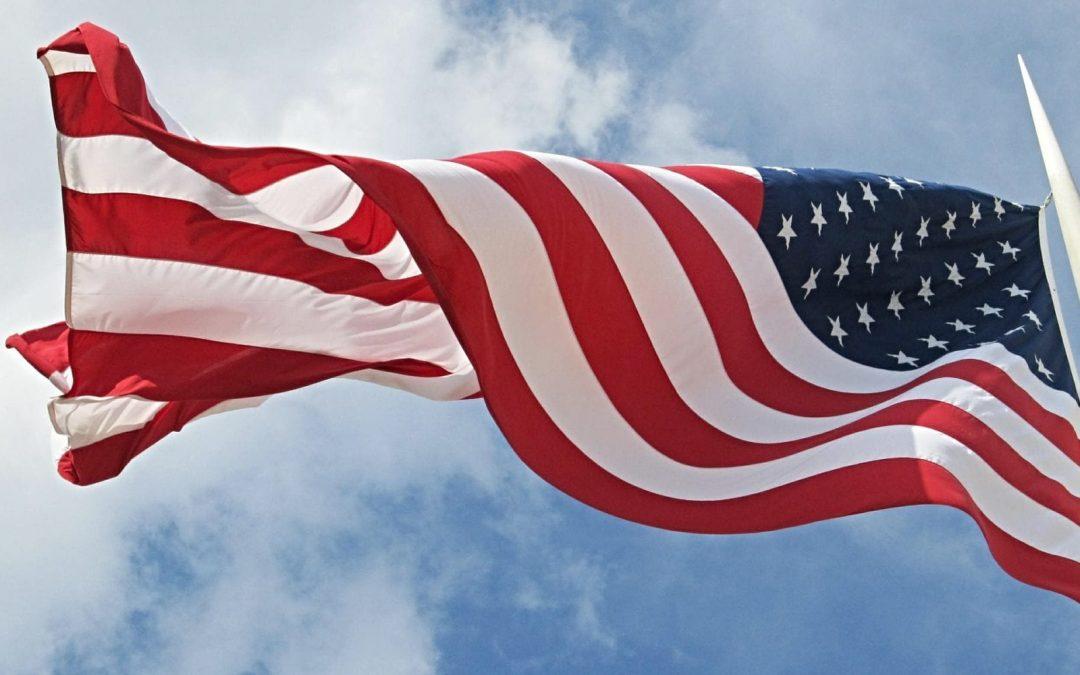 U.S. flag flying from flagpole