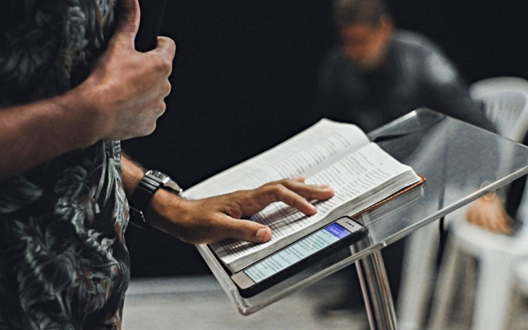 Close-up of person at pulpit with notebook