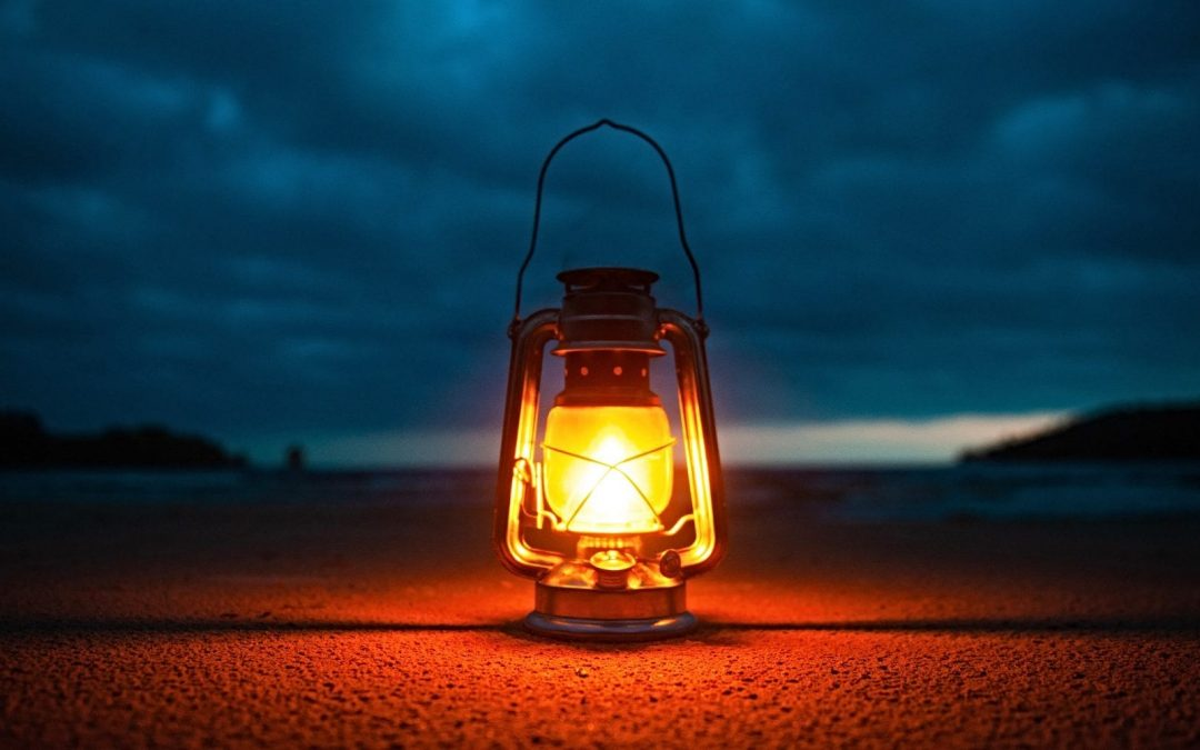 Lantern shining at night on ground