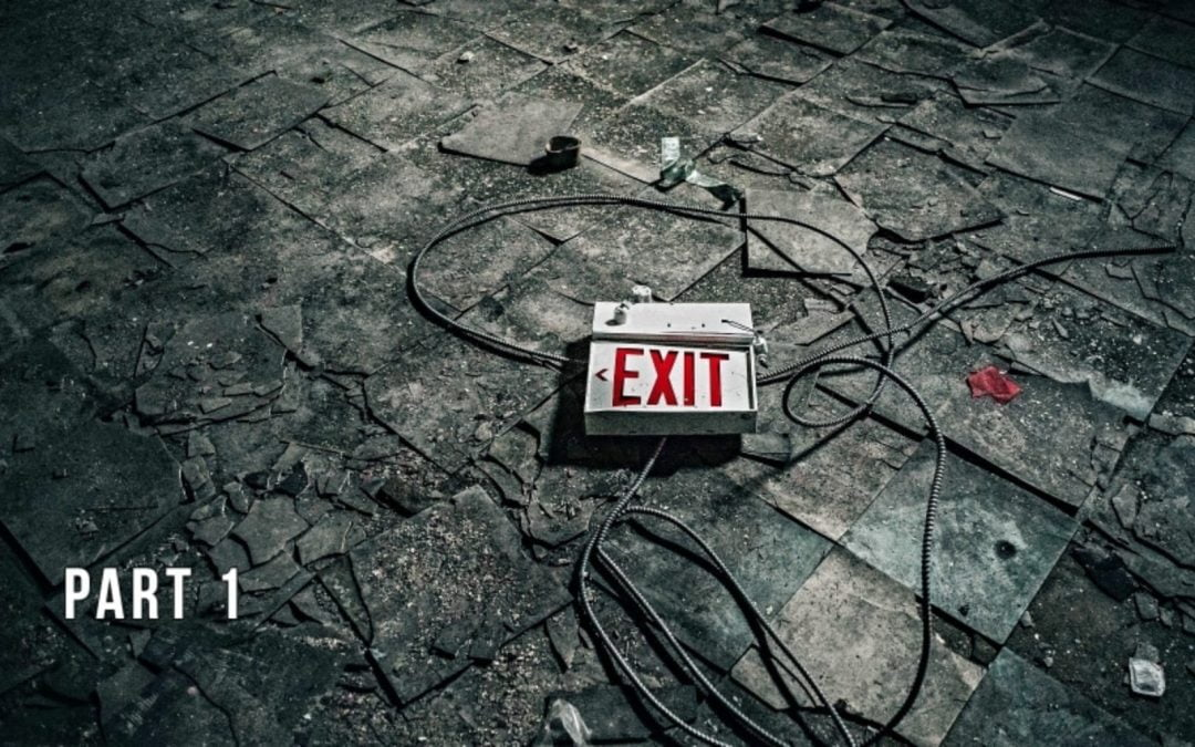 Busted exit sign laying on the ground