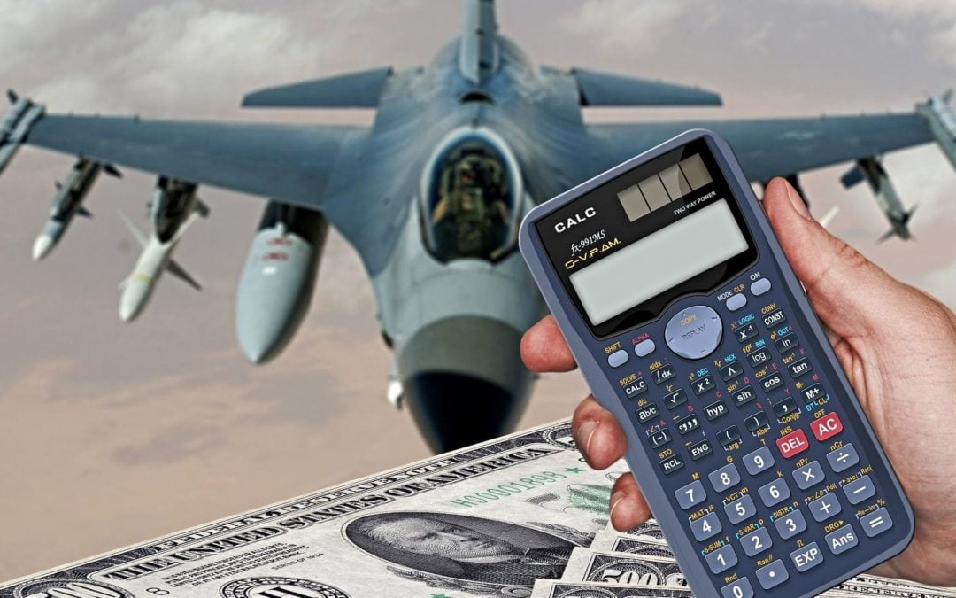 Calculator and $500 bills in front of military jet