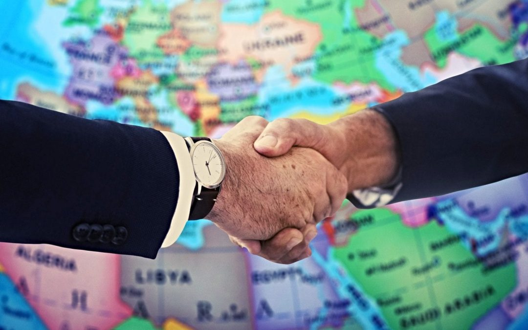Handshake in front of map of Europe