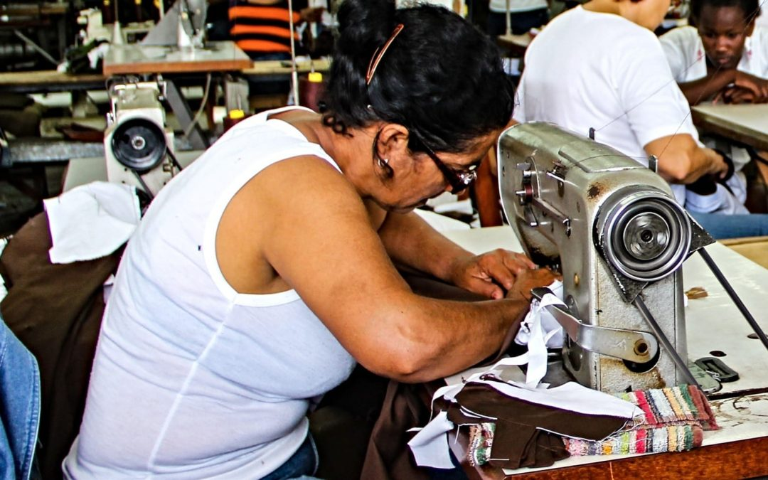 Woman working at sewing machine in factory