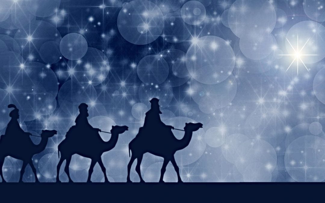 Three wise men riding camels in silhouette
