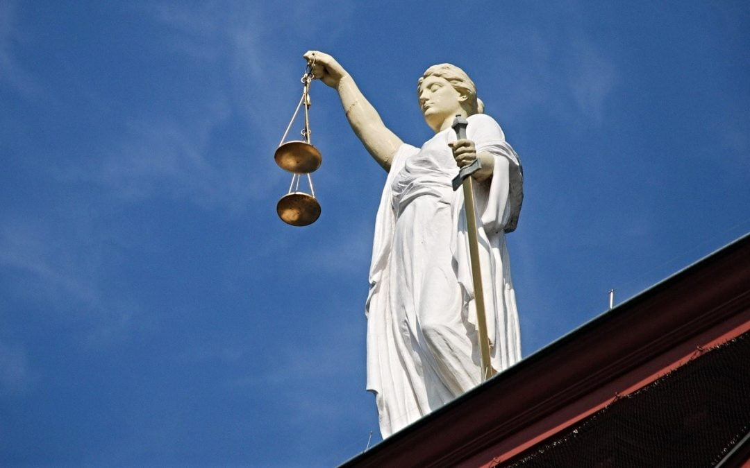 Statue of Justice holding scales and sword