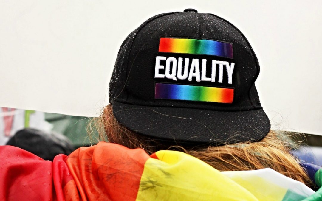 Person wearing cap with word 'equality' written on it