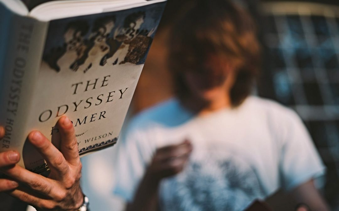 Person reading The Odyssey by Homer