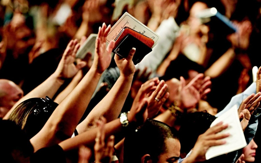 Hands raised in church congregation
