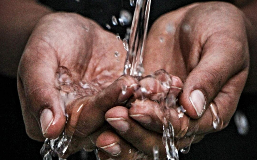 Water pouring on hands