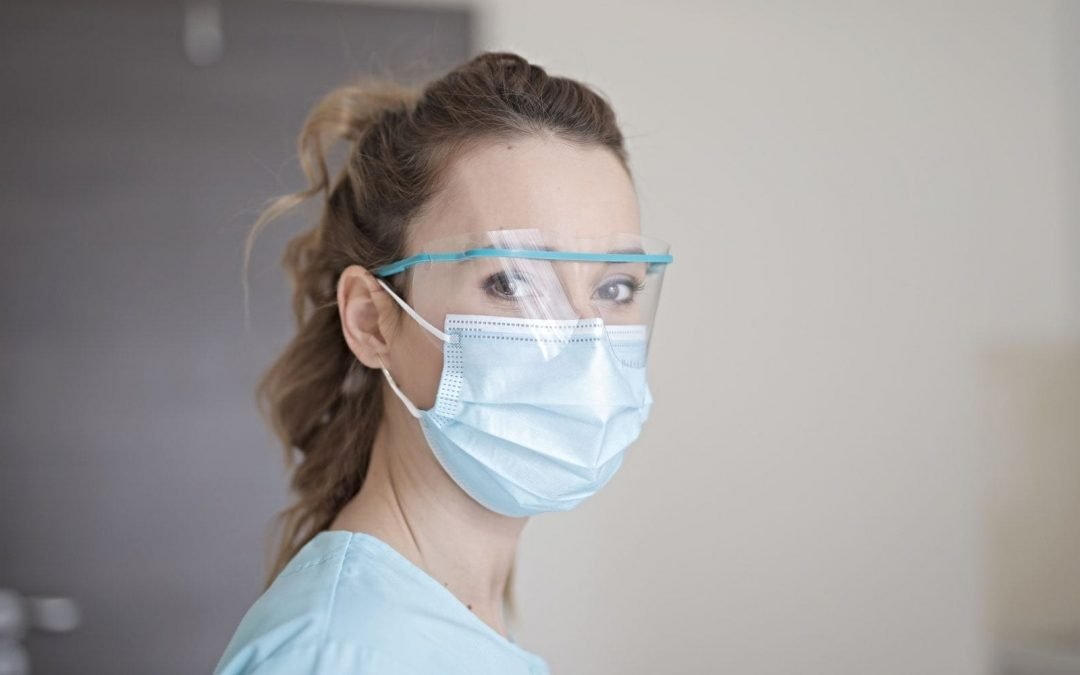 Nurse with surgical masks and goggles
