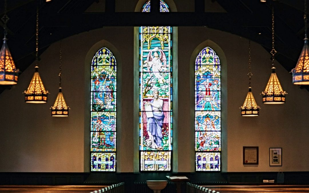 Stained-glass windows inside sanctuary