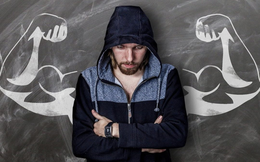 A man standing in front of a chalkboard with muscles on it.