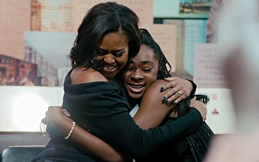 Michelle Obama hugging someone