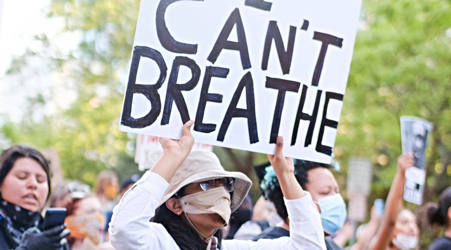 Protester marching with I can't breathe sign