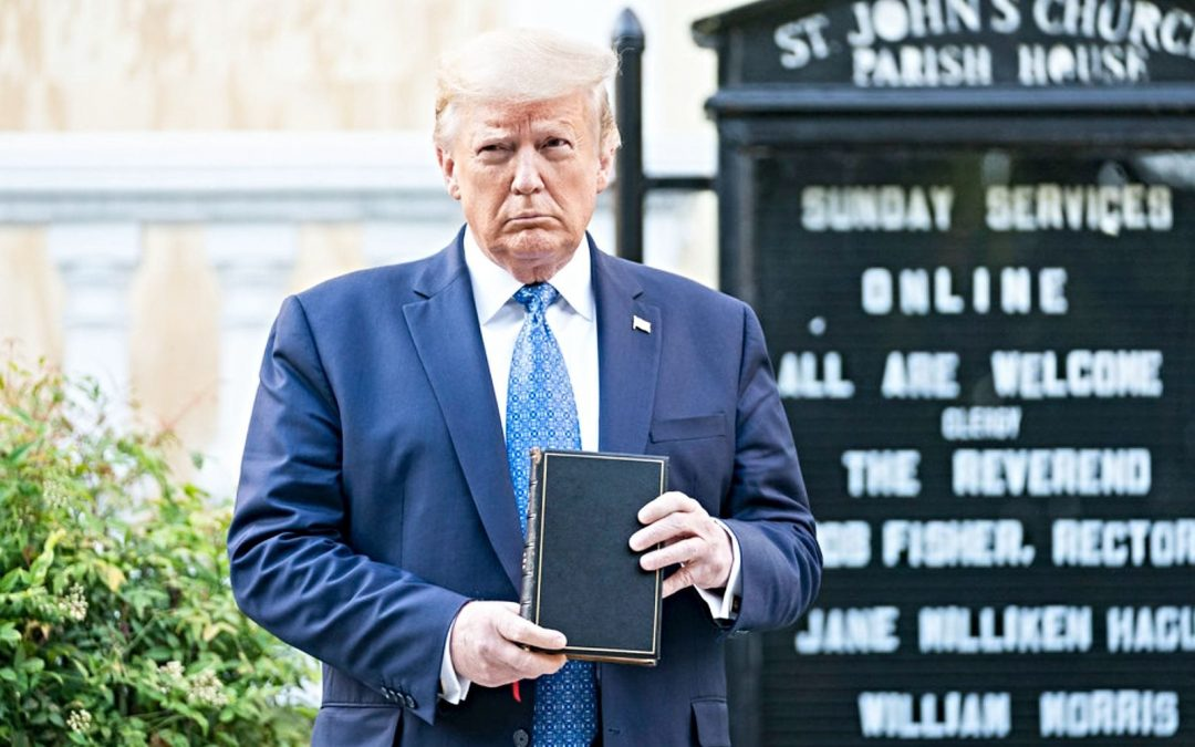 President Trump standing in front of church holding a Bible