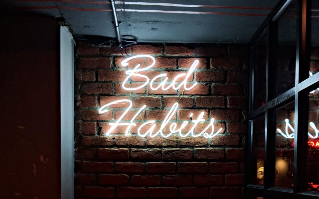 Neon sign with words Bad Habits