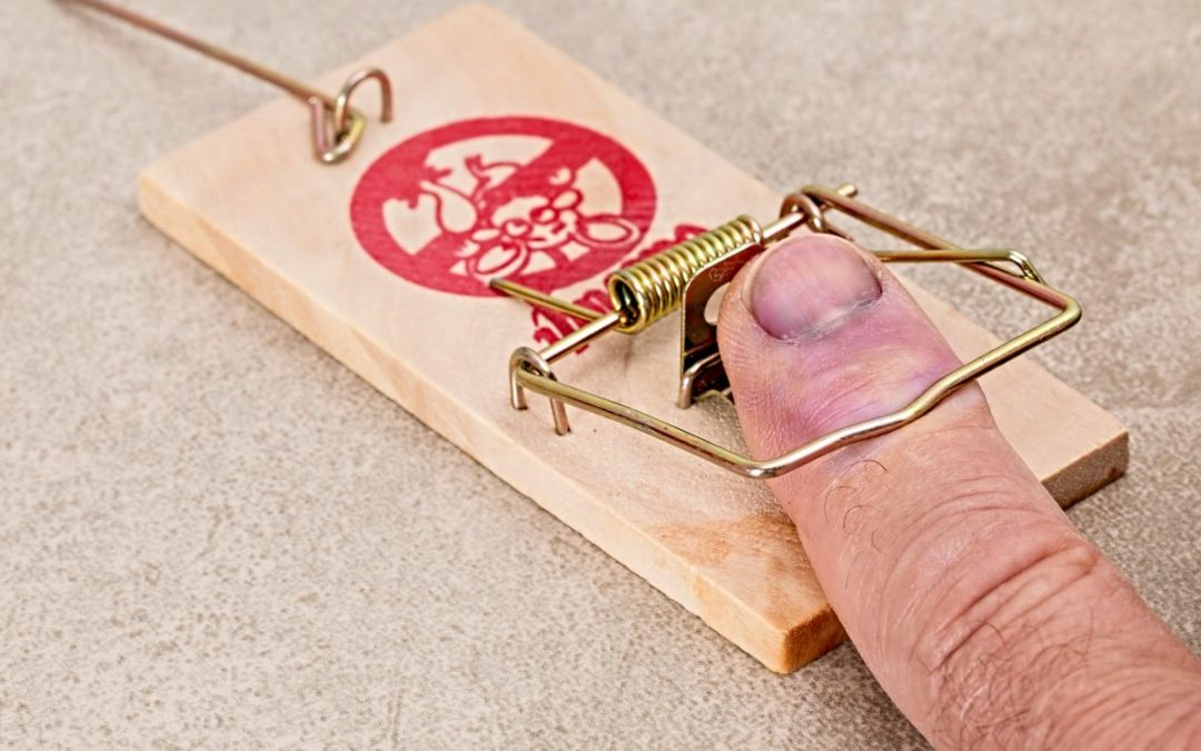 Man's finger caught in mousetrap