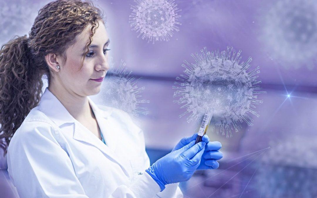 Clinical worker holding syringe with images of coronavirus